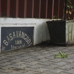 A sign for the Basavanagudi neighborhood in Bangalore is now covered by a sidewalk. Basavanagudi, like Malleswaram, was an early suburb. (Photo: Kelly Zegers)