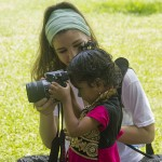 A young girl gets photography lessons from Krysten Massa. (Photo: Rick Ricioppo)