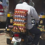 A man rides with 30 dozen eggs on the back of his bike, with dozens more between his legs. (Photo: Rick Ricioppo)
