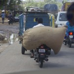 Driving down Mysore Rd with a large sack strapped to the back. (Photo: Rick Ricioppo)