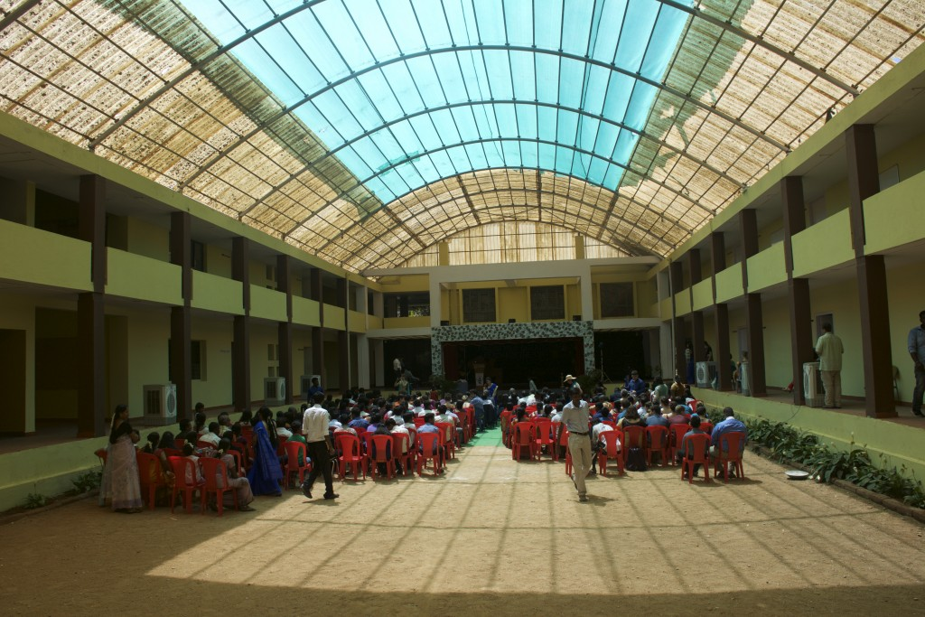 The graduation took place in a classroom building with a large, central assembly area. (Photo: Kelly Zeegers)