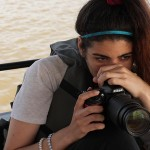 Diana Lopez is ready to snap a photo at any moment on a boat in the Kabini River. (Photo: Krysten Massa)