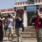 Kelly Zegers, left, Peter Dorr, Kevin Matyi and Marvin Fuentes take in the sights at a temple in Malleswaram. Visitors had to remove their shoes before entering the site. (Photo: Rick Ricioppo)