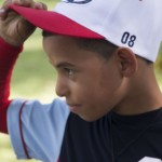 A player adjusts his cap before taking the field. Photo by Briceyda Landaverde.