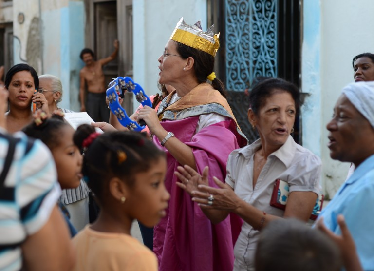 A woman helps lead a religious festival in Old Havana. Photo by Briana Lionetti.