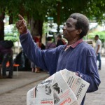 A man in Old Havana sells international editions of Granma, one of the official newspapers of Cuba. [Photo Credit: Janelle Clausen.]