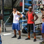 Coach Nardo Mestre Flores works with a group of boxing students. Photo by Janelle Clausen.