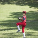 A young pitcher winds up to throw a pitch. Photo by Kayla Shults.
