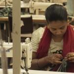 A seamstress checks her work. (Photo: Krysten Massa)