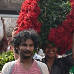 A man carries red roses outside the city's wholesale flower market.  (Photo: Diana Lopez)