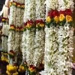Bridal flower garlands hang outside a vendor's stall. (Photo: Alicia Bermudez)