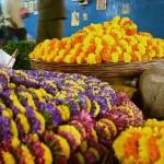 Inside City Market, garlands await a buyer. (Photo: Alicia Bermudez)