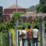 Three young men make their way to the State Central Library at Cubbon Park. The library was established in 1915. (Photo: Kelly Zegers)
