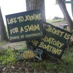 Signs warn swimmers about crocodiles in the Kabini River. (Photo: Rick Ricioppo)