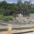 Just outside of Bangalore, garbage piles by riverbank. PC Rick Ricioppo