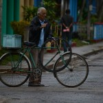 A man with his bike along a road in Vinales, where there are a number of casa particulares. Photo by Janelle Clausen.