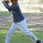 A player in a worn-out Yale University t-shirt gets ready to swing. Photo by Janelle Clausen.