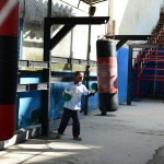 Jorli, 5, practices his left hook and right hooks at the Rafael Trejo boxing gym in Havana. This particular boxing gym has people of all ages learning how to box. Photo by Briana Lionetti