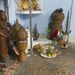 In the corner of the room inside the House of Santeria lays a display of gifts to the gods. These gifts include fruits, vegetables and cups of animal blood. Photo by Rick Ricioppo.