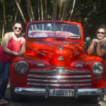 Alexa and Briceyda pose next to an old car. Photo by Rick Ricioppo.