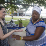 Alexa gets her palms read by a Santeria woman in Regla. Photo by Rick RIcioppo.